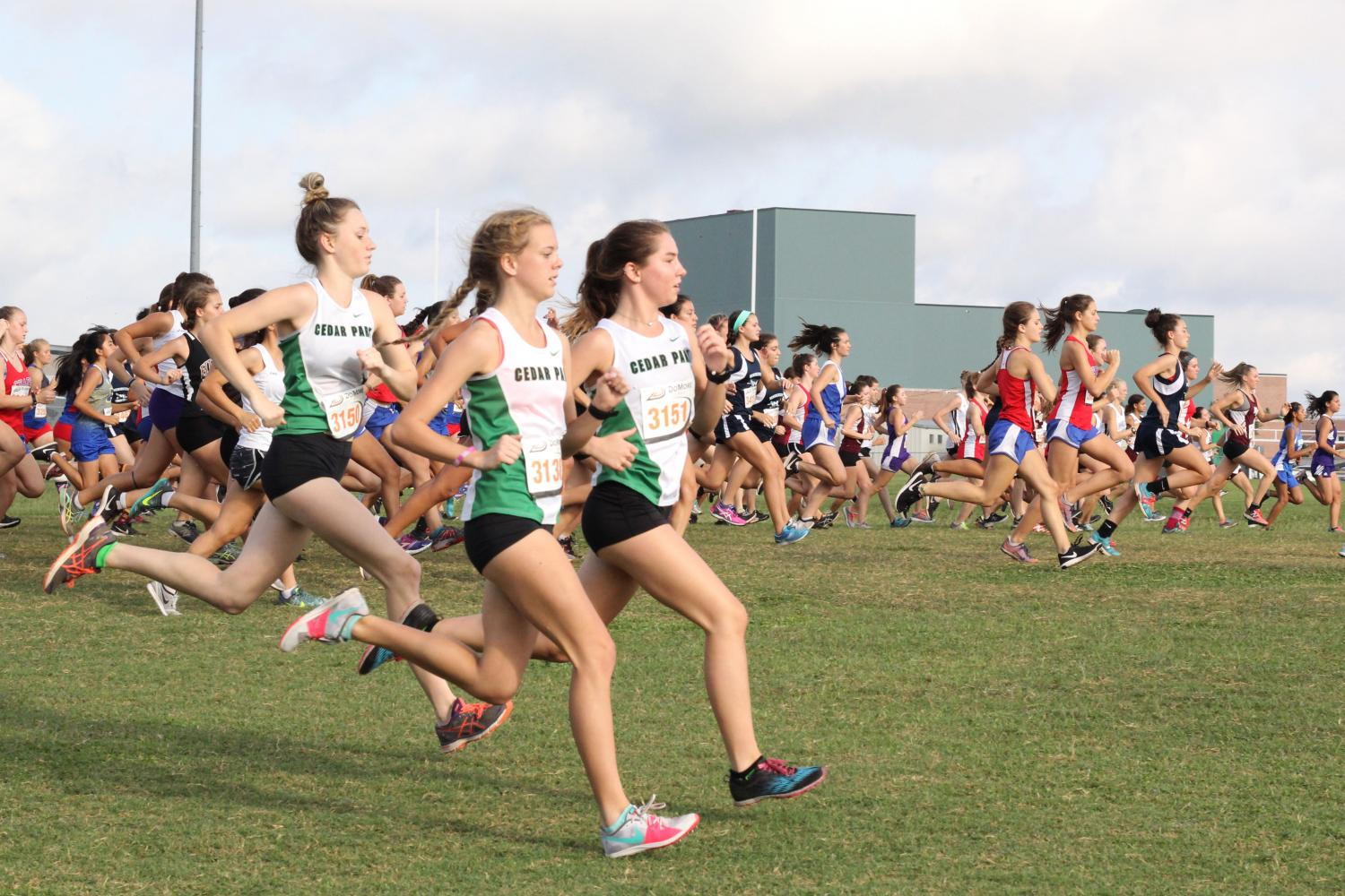 The JV girls, including Kyla Woods and Erika Arthur, take off to start their meet on Sept. 16 at the Cedar Park Invitational.