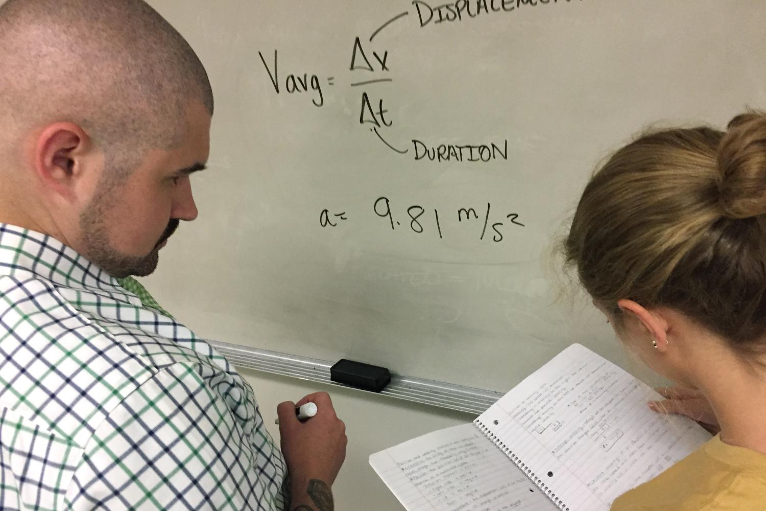 Stuck on a physics problem, junior Emma Weddell gets help from Biology teacher Adam Babich. She decides to go to him over anyone else.
