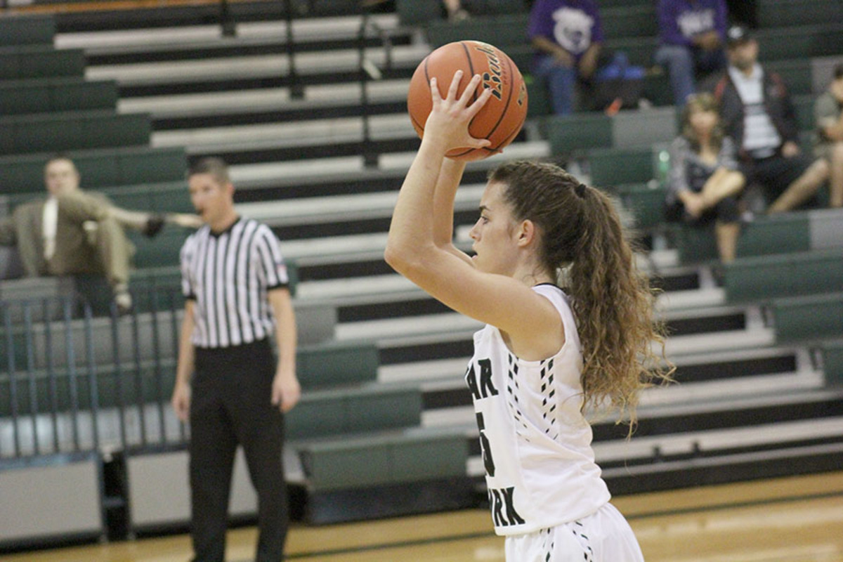 Senior Kilee West passes the ball at their first game of the season against Hutto on Nov. 28.