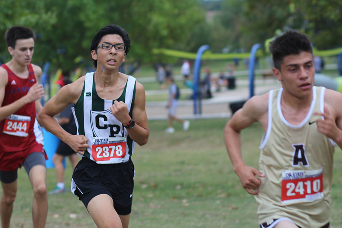 Competing at the state meet on Nov. 4 at Old Settlers Park, junior Alden Yi works hard to finish the race. Yi was one of the members of the Varsity boys team that placed 3rd overall.