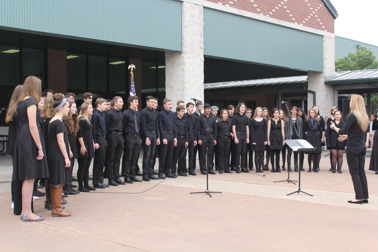 The choir sings the National Anthem in the Veterans Ceremony on Nov. 10.