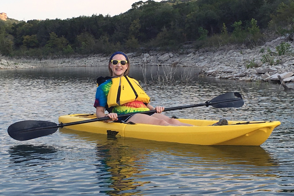 Paddling in a kayak, sophomore Kira Niedert stays positive. She had just come to terms with having cancer.