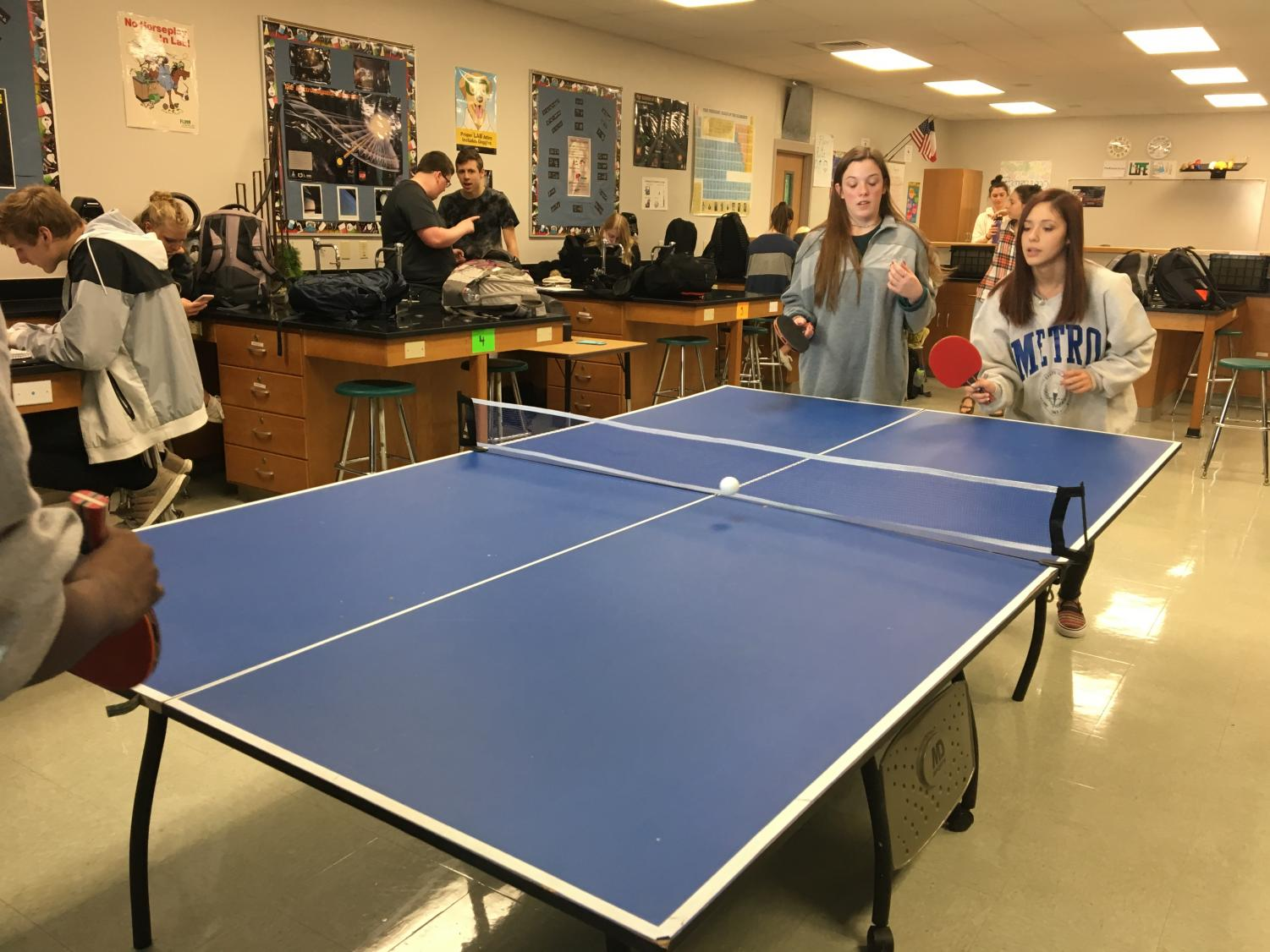 Junior Kasey Korbakes and sophomore Lolah Colins play a game of ping pong in ping pong club on Jan. 12.