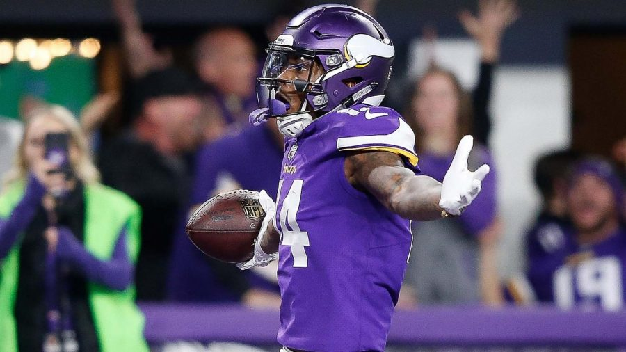 Stefon+Diggs+of+The+Minnesota+Vikings+scores+the+game+winning+touchdown+against+the+New+Orleans+Saints+in+an+NFC+divisional+playoff+game%2C.