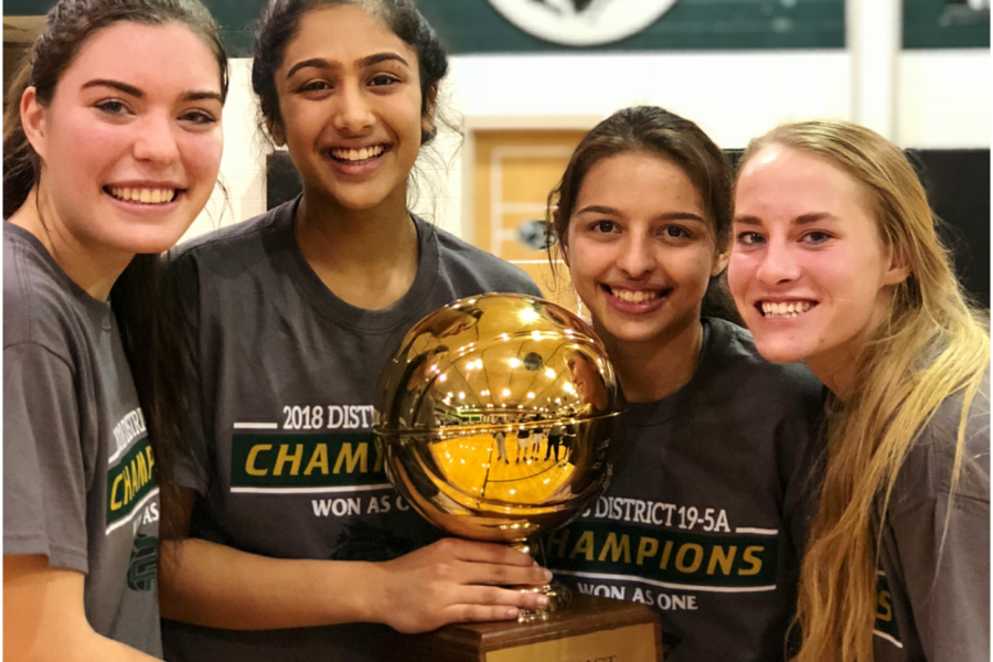 Junior+Pujita+Shukla+celebrates+with+her+teammates+senior+Annie+Callahan+and+Kalee+West+and+freshman+Sarai+Estupi%C3%B1an+after+winning+outright+district+championship+on+Feb.+6.+