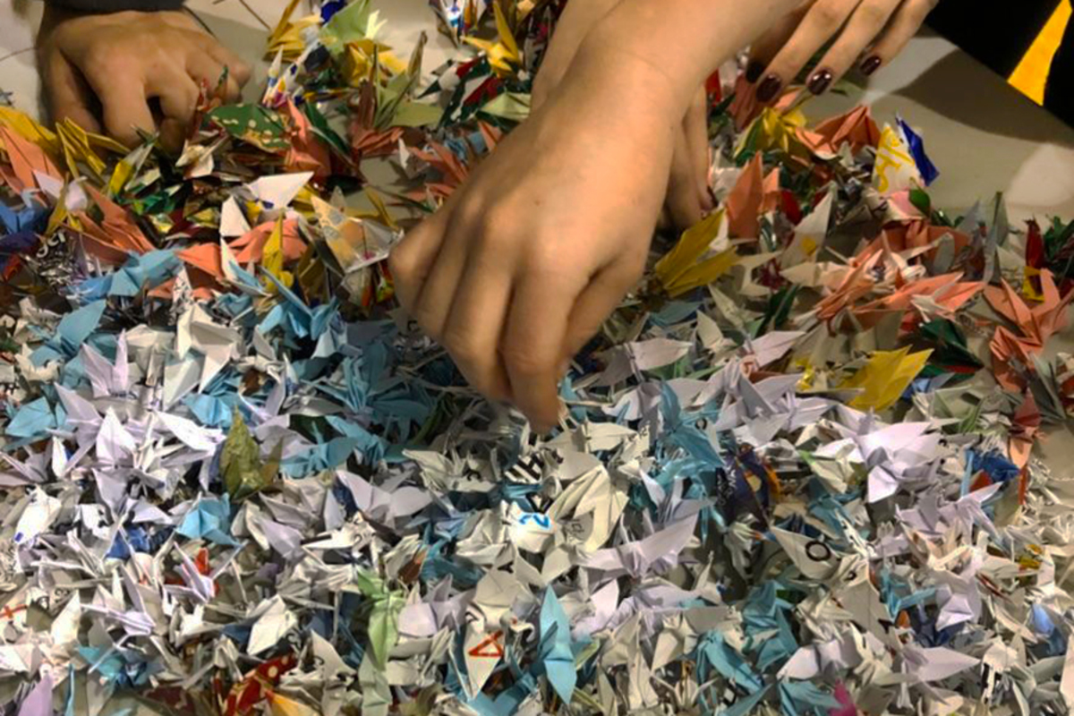 Rooting through the 2,000 paper cranes Sue Stifflemire made for coach Stacy Danielson, dancers were in awe.  Junior Becca Thiemann said the kind act meant a lot to her and the team.