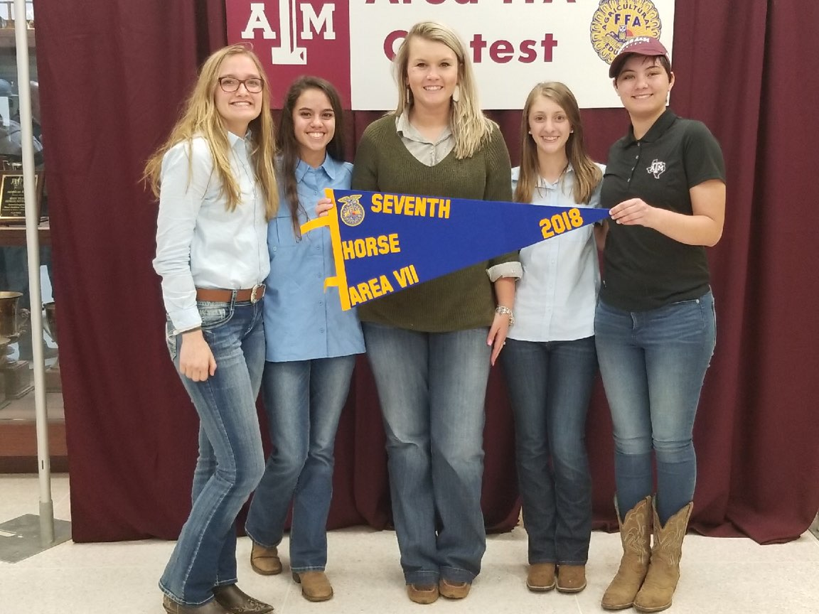 The horse judging team and coach receive their seventh place prize for their performance at the area meet.