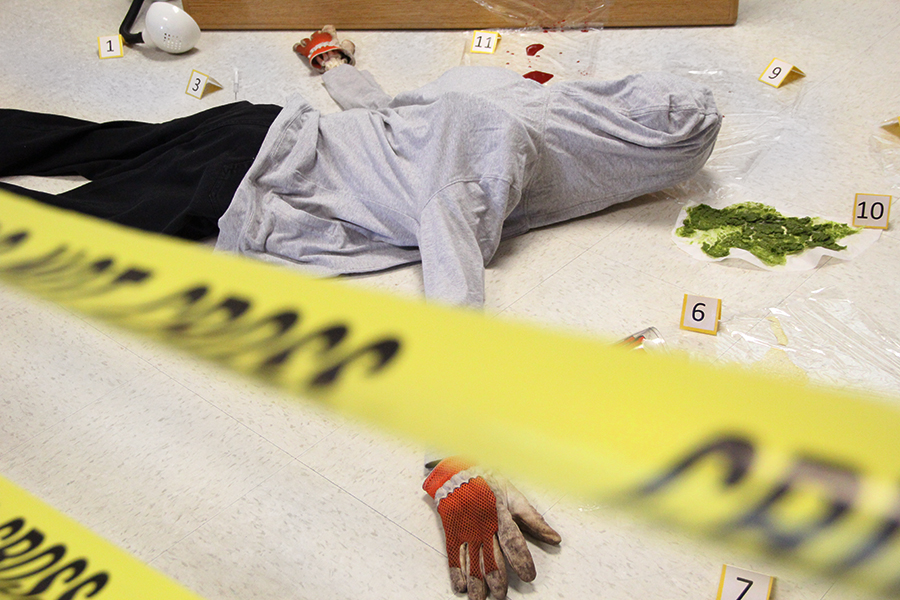 "The body of Anna Garcia lays on the floor of the upstairs A-building alcove on Aug. 20. Garcia was placed here by Principles of Biomedical Science teacher, Nancy Matthias, so her students could crack the annual case throughout the year. ""We learn through our curiosity, we learn through doing,"" Matthias said. ""By letting the students come up with their own ideas, their own theories, they learn it better because it is hands-on."""