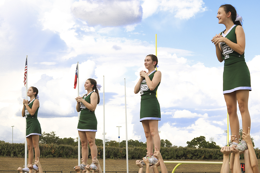 JV cheer team pumps up the student section at the Cedar Ridge JV football game on Sept. 6.