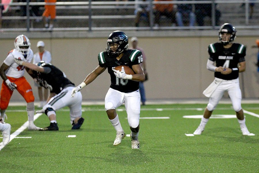 Junior running back Jonathan Stockwell looks for an opening against San Angelo on Sept. 14 at Gupton. Stockwell scored his first rushing touchdown during the first quarter.