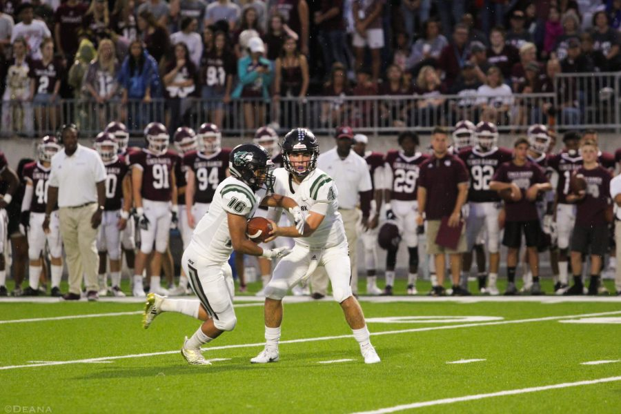 CPFB+now+sits+at+2-2+following+their+14-13+victory+over+Cinco+Ranch.+Sophomore+QB+Ryder+Hernandez+hands+off+to+junior+RB+Jonathan+Stockwell+on+Sept.+21+at+Katy+Cinco+Ranch.+%22It+was+important+to+end+non-district+play+with+a+win%2C%22+Hernandez+said.+%22We+have+some+momentum+going+into+our+next+games.%22%0A