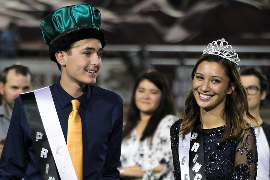 Senior Riley Pangilinan joins senior Dalton Hartmann as they were crowned homecoming king and queen on Sept. 29 at Gupton Stadium.