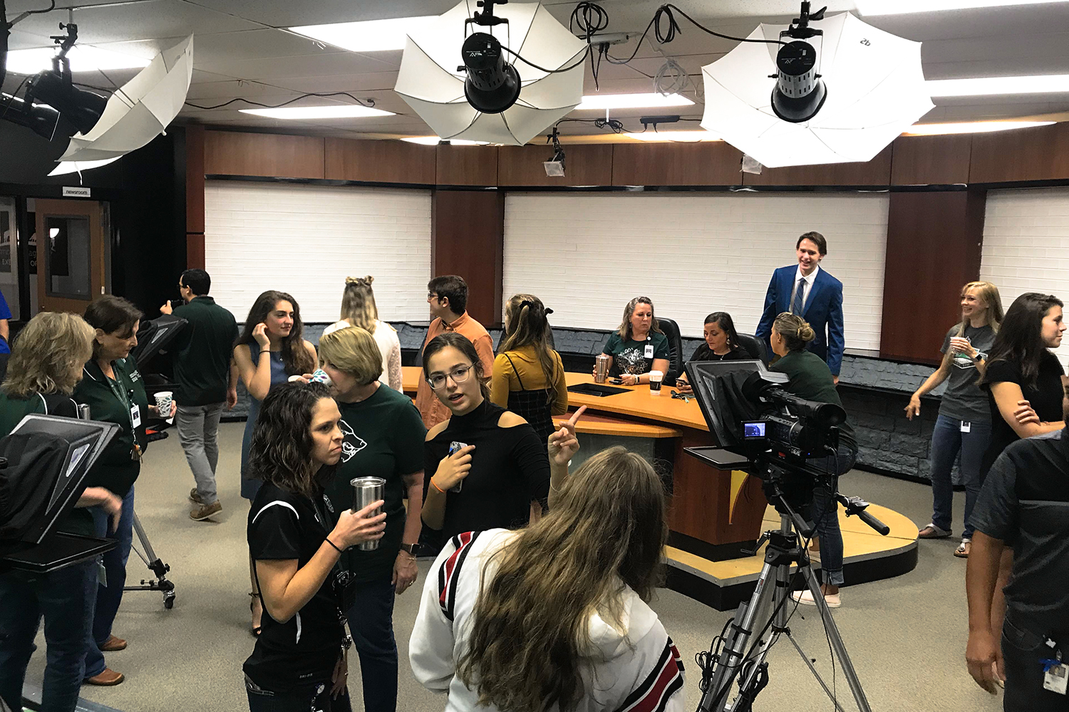 Giving a grand tour, junior Iriyana Lipkin shows off the newest features of the newly acquired KVUE set. The broadcast staff worked since late August on remodeling.