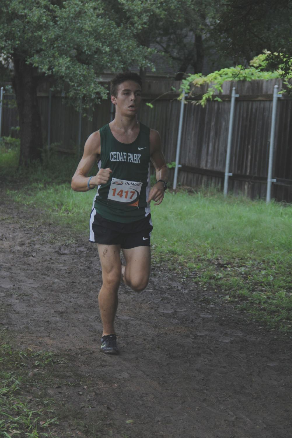 Dashing through the dirt, junior runner Tanner James looks to finish the CP Invitational strong.