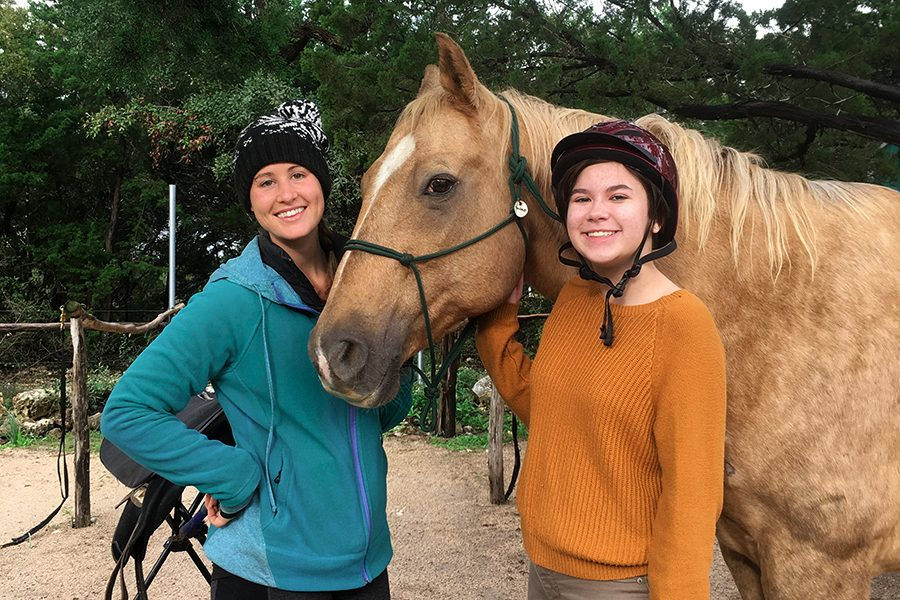 Helping+out+Jess+Gilles%2C+an+instructor+for+Hopeful+Hearts%2C+freshman+MJ+Kelly+poses+with+horse+Hercules+on+Oct.+20.+Kelly+rode+on+Hercules+and+practiced+their+trotting+and+right+diagonal.+%22Hercules+is+a+really+chill+horse%2C+but+once+you+get+him+going+he+can+go+really+fast+and+do+some+incredible+things%2C%22+Kelly+said.+%22He%27s+also+super+sweet%2C+so+he+works+well+with+kids.%22