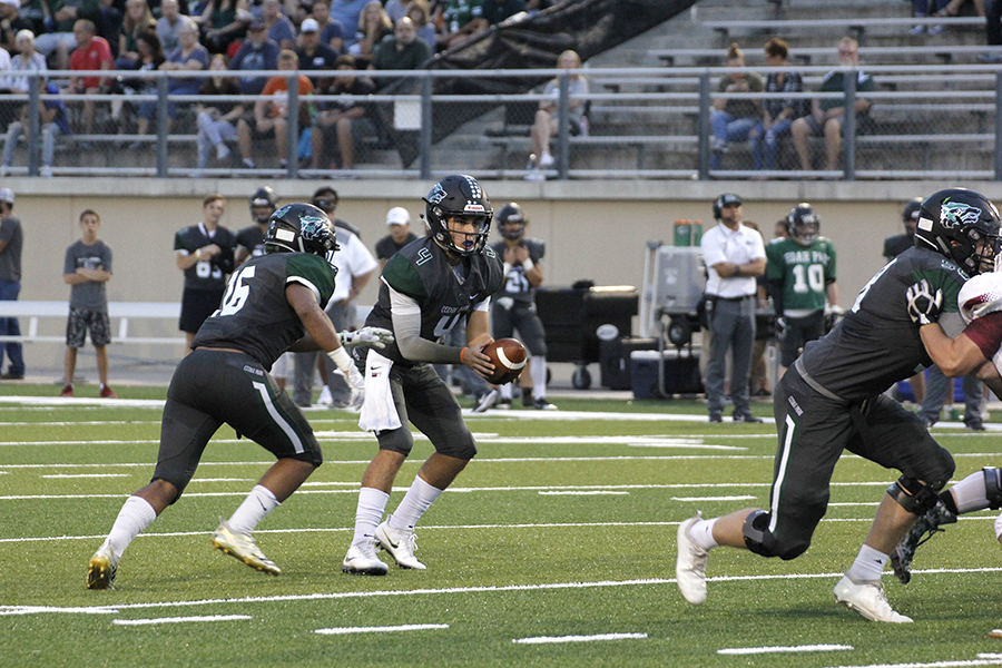 Sophomore QB Ryder Hernandez reads the defense during a run-pass option play 9/28 against Rouse.