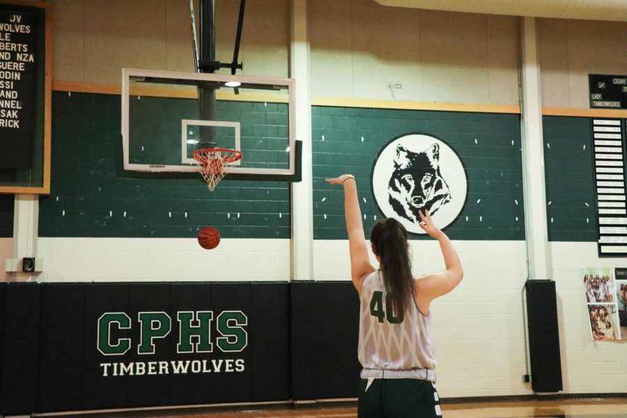 Warming up before practice, varsity captain, junior Nicole Leff, prepares for the Lady Timberwolves' first game. The team has been practicing since early August to prepare for their tough preseason schedule.