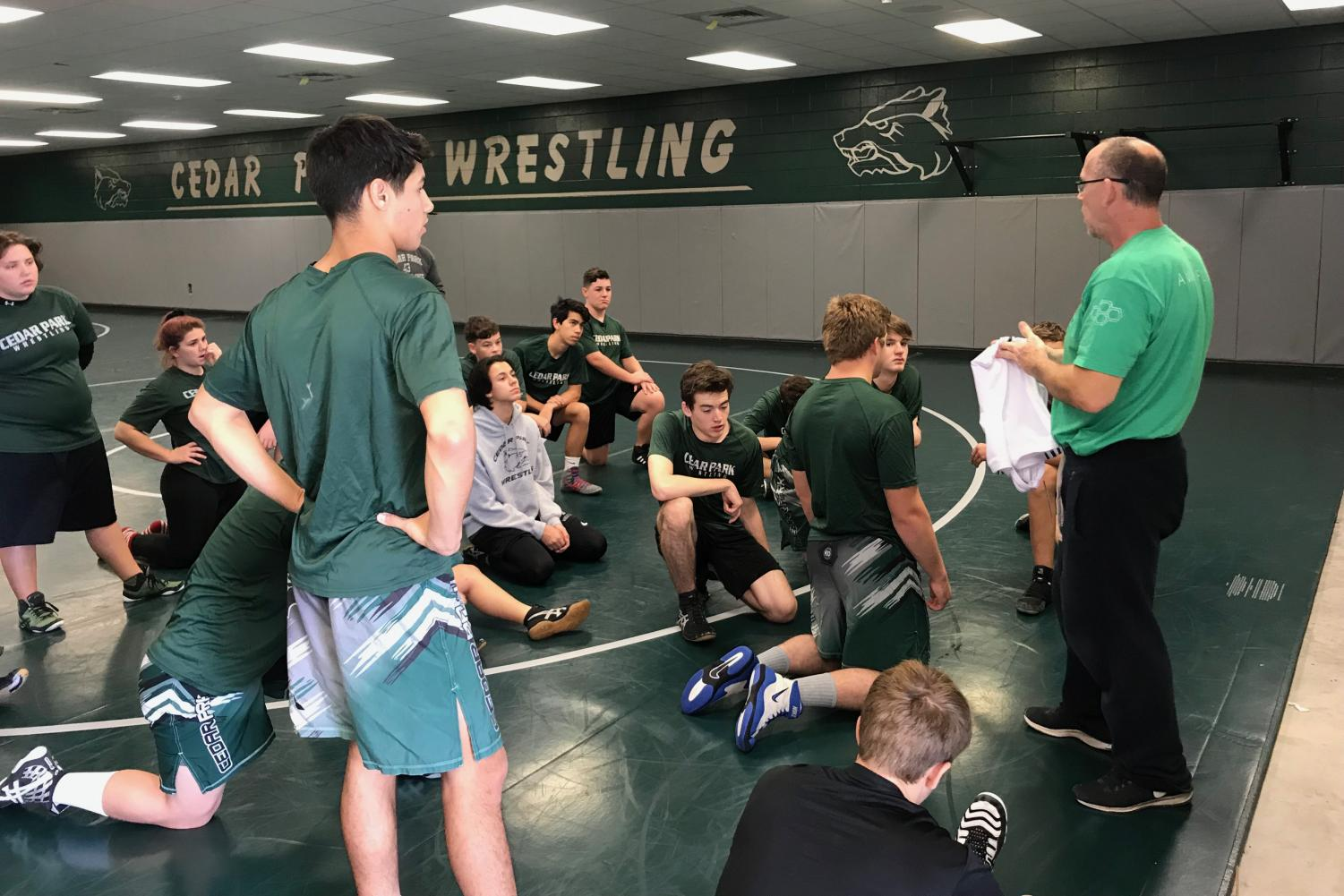 Listening to Coach Peterson, the wrestlers try to absorb all information given to them.