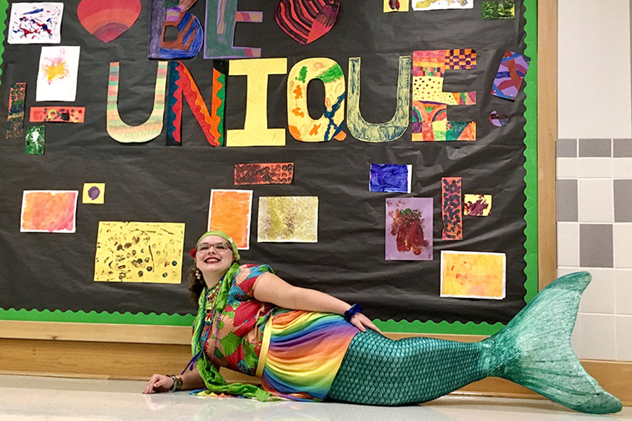 Junior Loree Morin poses in her mermaid tail before school on Oct. 23. Morin said that she has always wanted to be a mermaid and became a mermaid instructor at Aquamermaid School in Austin in September.