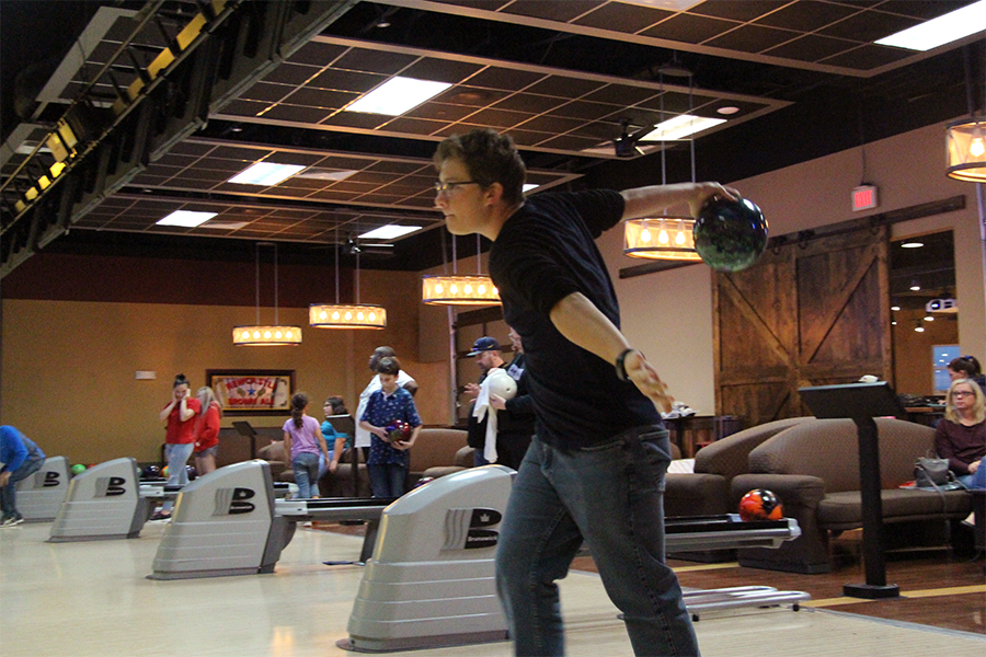 "Raising his back swing in the air, junior Nick Martin continues his approach in order to pick up a spare.  ""I'm getting better each and every time I go bowling,"" Martin said."