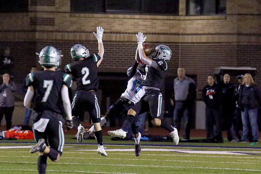 Leaping up, junior safety Tammer Alzer intercepts a pass against Shadow Creek on Nov. 23. The Timberwolves lost to the Sharks 21-14.