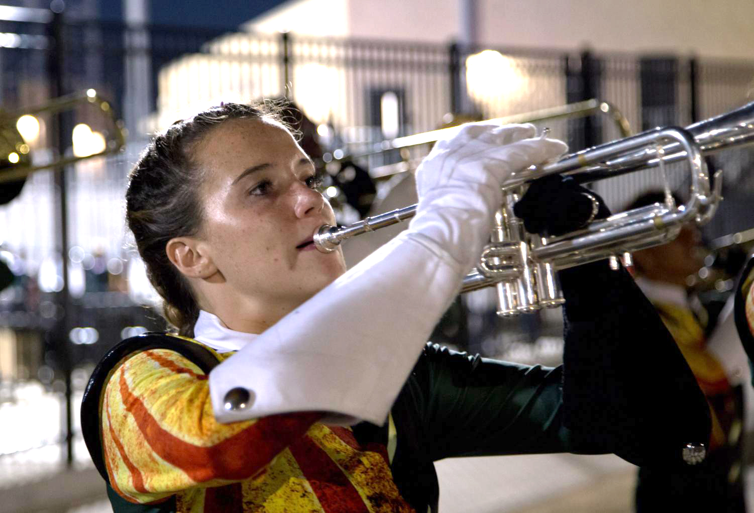 Playing trumpet,  junior Kaity Rhine plays with the rest of the band at an away football game against Conally.