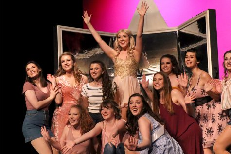Junior Lindsay Dove, portraying Elle Woods, is surrounded by her Greek chorus as the final notes of