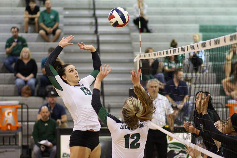Senior+varsity+volleyball+player+Shelby+Epley+hits+the+ball+over+the+net.