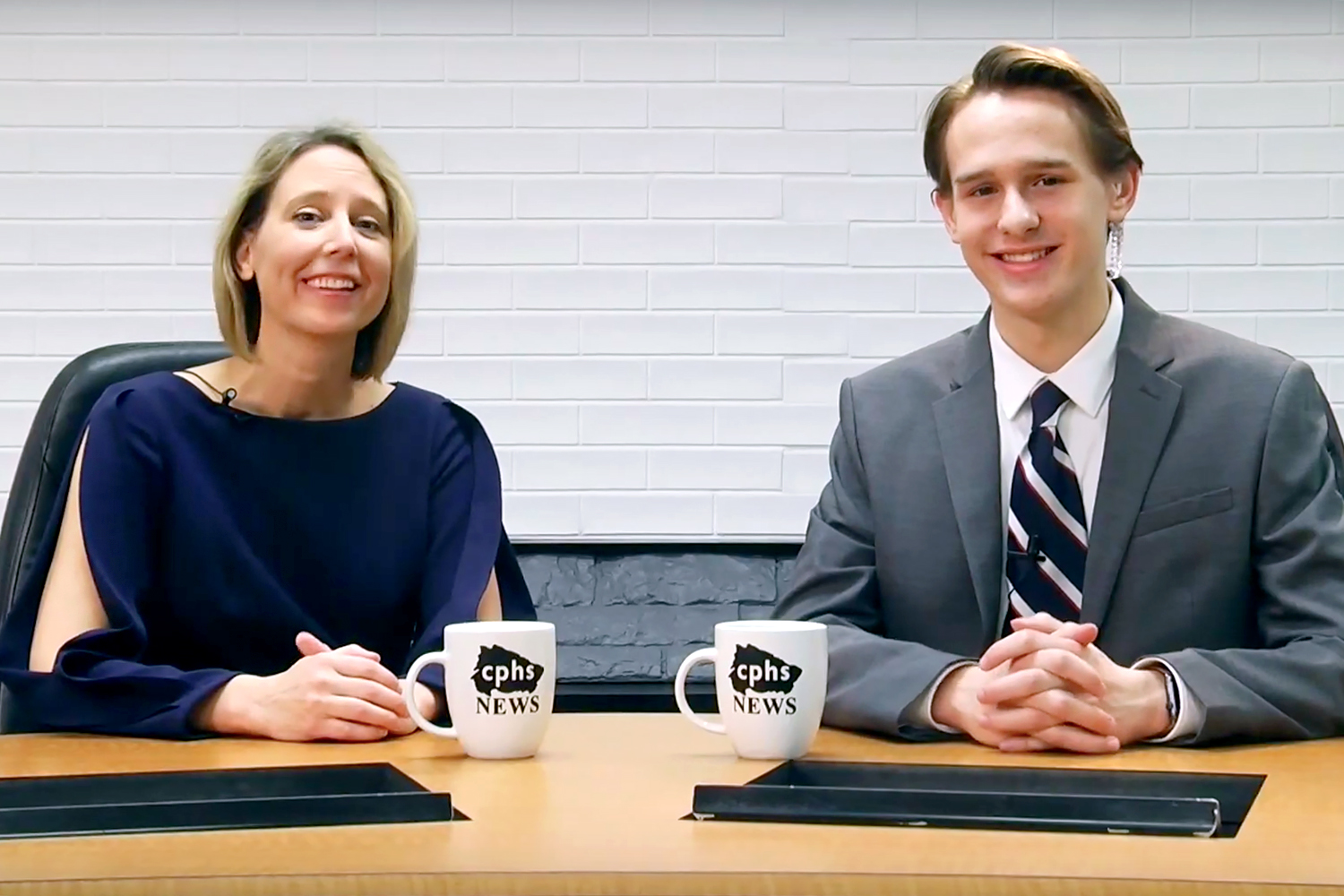 Anchor junior Evan Vines sits with Place 1 trustee, Trish Bode, while filming the The Wolfcast on Jan. 17.