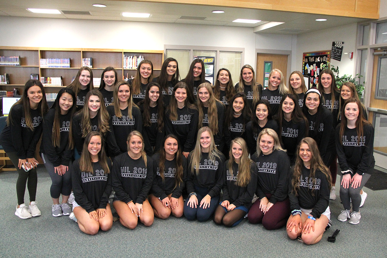 Before beginning their send-off on Thursday, Jan. 17, cheer waits in the library for their cue. Cheer competed on Saturday, Jan. 18,  at the UIL Spirit State Championship in Fort Worth TX.