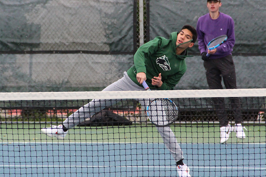 Junior Bryce Bailey hits a net shot during the Georgetown tournament on on Feb. 8.