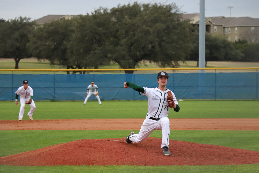 "Throwing a heater, senior pitcher Sam Householder pitches against the opposing batter. ""[My goals are] being an impact player on varsity and hopefully being a district pitcher of the year,"