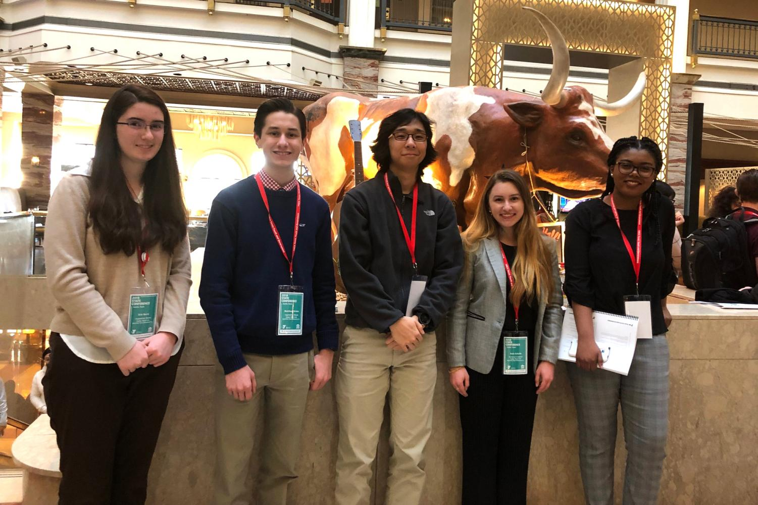 Juniors Erin Barry and  Matthew Grimm, senior Alden Yi, sophomore Kate Schulle and senior Kayla Frazier pose at the Texas Youth and Government State competition. All five members joined the club to pursue their passions in government and politics.