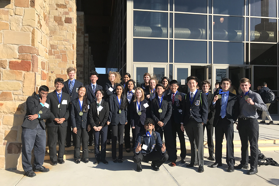 After competing on Jan. 19, DECA competitors line up to pose.