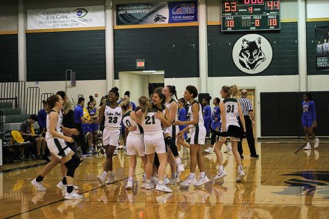 The Lady Timberwolves celebrate at half court after the final buzzer. The T-Wolves finished 14-0 in district, marking their second outright district championship and solidifying themselves in school history.
