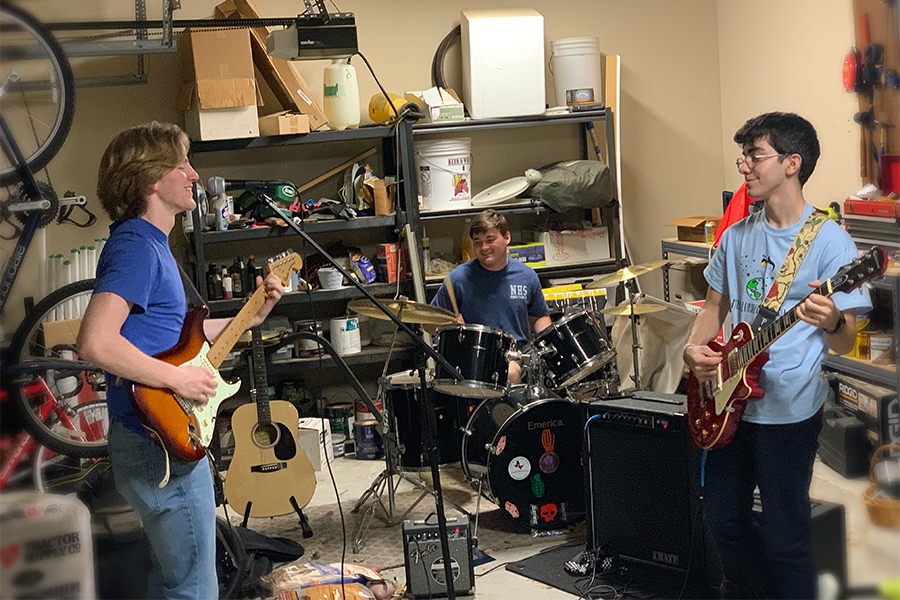 """Jamming out, The Loops rehearse music by Nirvana before learning new songs. """"I wanted to create a band because I wanted an outlet for my friends and me to continue to grow musically and to build the bond we have,"""" junior Luke Ferguson said. """"I love playing with the band because at that moment nothing else matters besides the song. You can really set aside worries and anxieties and just focus on making music."""""""