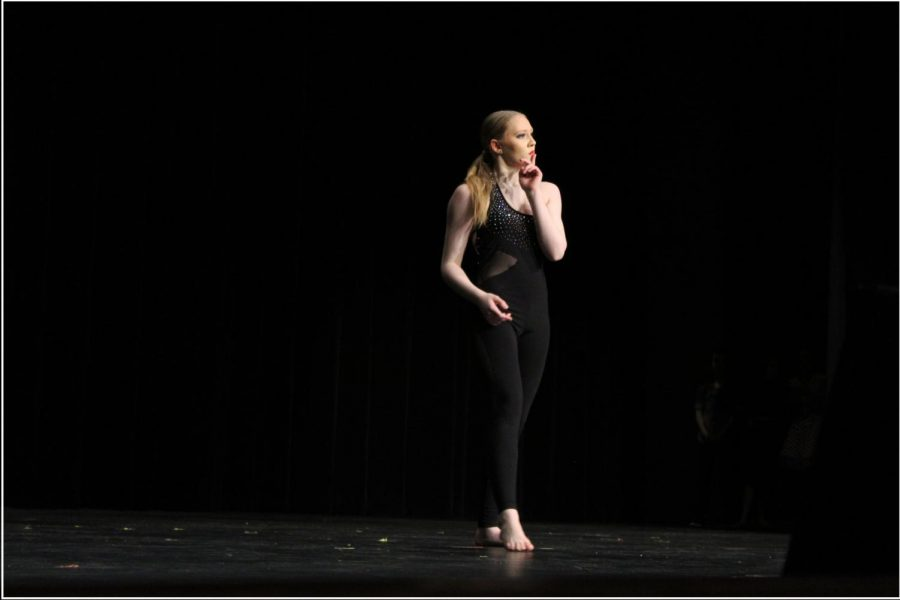 While+performing+her+solo+%22Champion%2C%22+freshman+Lexi+Hall+moves+across+the+stage+in+a+powerful+stance.+%E2%80%9CMy+jazz+solo+is+mainly+about+being+confident+in+myself%2C+my+ability+and+rising+above+my+insecurities%2C%E2%80%9D+Hall+said.+%E2%80%9CMy+contemporary+solo+was+focused+more+towards+improving+and+growing+in+my+movement.