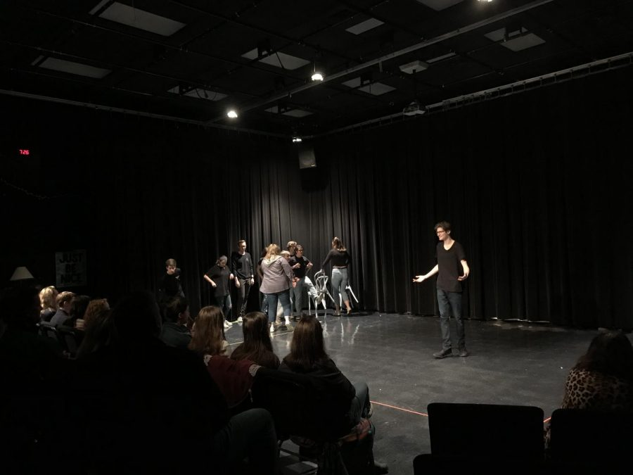 Junior Ethan Parks entertains the audience during the Penguin National Guard's improv show on February 27.
