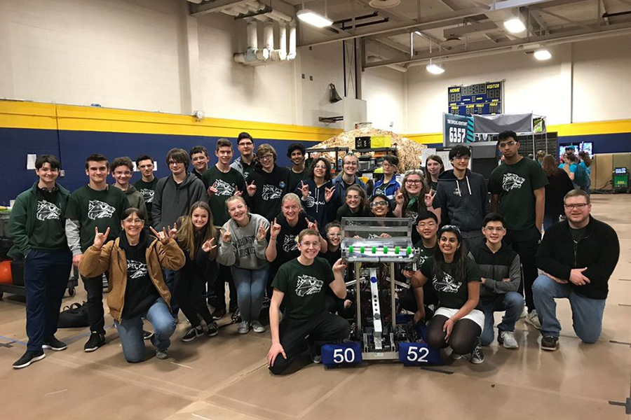 Smiling together as a team, members who went to the FRC Robotics district competition in Austin from March 1-3 show off their robot.