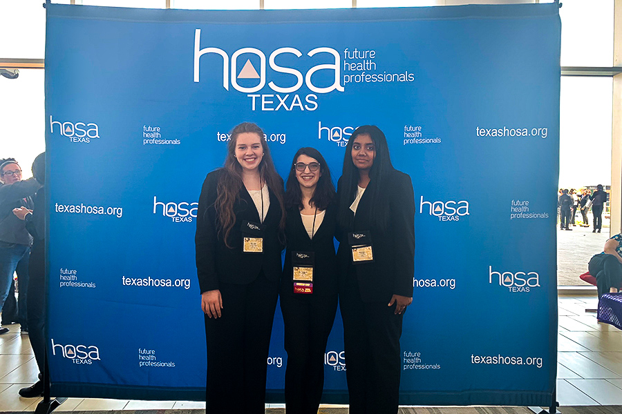 At HOSA's State Conference, freshman Aashna Ravi and senior Kristin Knight pose before their competitions with   junior Christina Laskaris who served as courtesy core. Of the competitors, Knight advanced to Internationals which are being held on June 19-22 in Orlando, Florida.