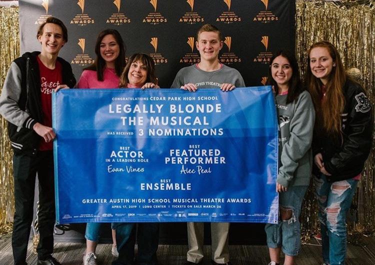 Juniors+Evan+Vines%2C+Justin+Ballou%2C+Lindsay+Dove%2C+sophomore+Riley+Vines%2C+senior+Amelia+Vidrine+and+theater+teacher+Alisa+Mirabella+pose+around+their+GHATSMA+award+banner.