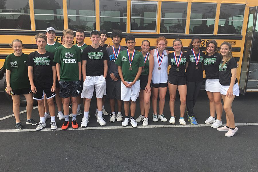 The+JV+tennis+team+poses+with+their+district+medals.+%E2%80%9CWhen+I+got+first%2C+I+was+surprised+and+happy+knowing+that+my+hard+work+had+paid+off%2C%22++sophomore+Madison+DeFalco+said.