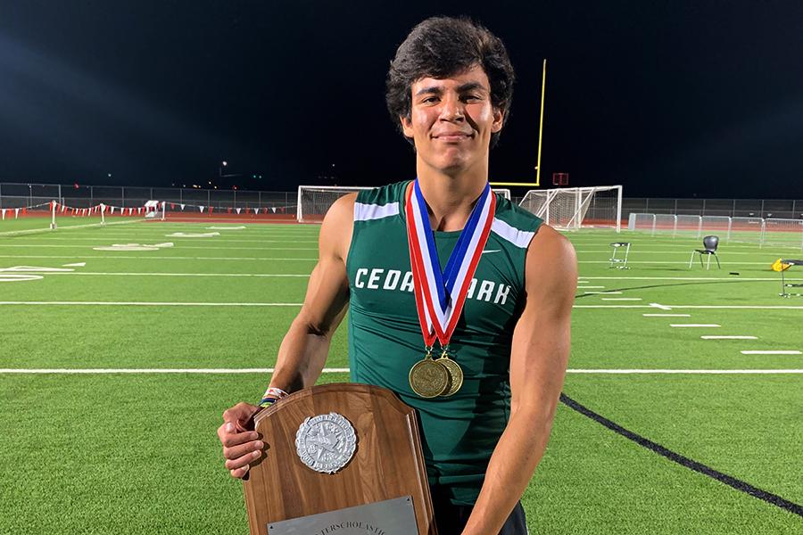 Senior Aaron Esparza holds the district champion award.