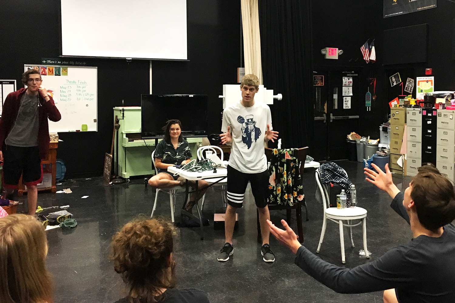 "Troupe 6289's Thespian president, senior Carson Burke, speaks to fellow thespians before rehearsals. ""I decided to run for president because I appreciated what the department had done for me,"" Burke said. ""I knew how much I loved everyone there, and I knew that I wanted to give something back to them. Organizing things seemed like the best way to do that."""
