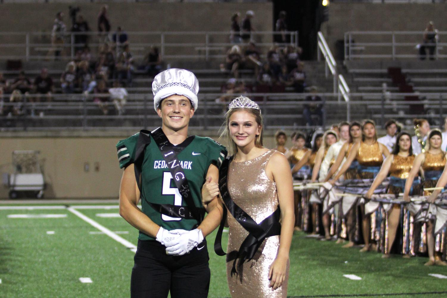 Posing together, seniors Majeston Haverda and Grayson Moore accept their crowning as homecoming king and queen on Sept. 20. Both Haverda and Moore said they were grateful for the opportunity their fellow peers granted them.
