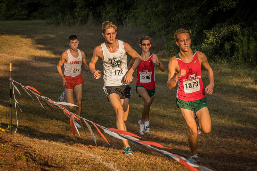 Competing+in+a+cross+country+meet%2C+junior+Jack+Woods+runs+towards+the+finish+line.+Woods%2C+who+has+been+running+for+more+than+10+years%2C+is+taking+this+as+an+opportunity+to+prove+that+his+work+has+paid+off+and+hopefully+hit+the+times+needed+to+run+in+college+in+the+future.%E2%80%9CWe%27ve+dialed+our+training+down+the+last+two+weeks%2C+especially+this+week+so+that+our+legs+and+body+can+be+well+rested+and+go+out+and+race+the+best+possible%2C%E2%80%9D+Woods+said.+%E2%80%9CMentally+I%27m+not+that+nervous+yet%2C+but+it%27s+not+our+last+race+and+%5Bit%5D+doesn%27t+define+our+season%2C+so+%5BI%27m%5D+just+not+trying+to+focus+on+it+being+the+end.%E2%80%9D