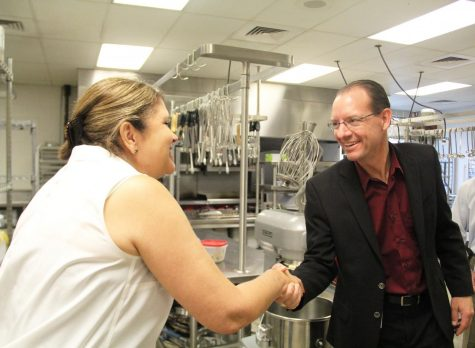 Dr. Gearing meets with culinary teacher Edwina Hayden.