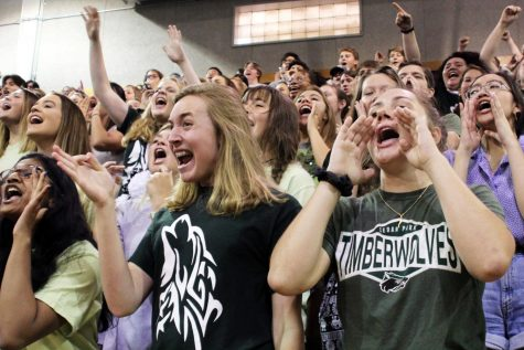 Students cheer during the home coming pep rally on Sept. 20.  The success of the pep rally was due to students like those in broadcast, who prepared the line up, the scripts and hosted the pep rally.