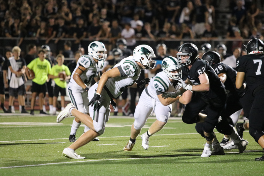 DLs+Hunter+Hewitt+%2895%29+and+Ben+Bell+%2899%29+rush+Vandegrift+QB+Dru+Dawson+on+Aug.+31.+Bell+led+the+way+for+the+defensive+line%2C+finishing+with+a+sack%2C+three+QB+hurries+and+around+10+tackles.+%22We+were+just+playing+for+each+other+trying+to+get+the+ball+in+the+offense%27s+hands%2C%22+Bell+said.