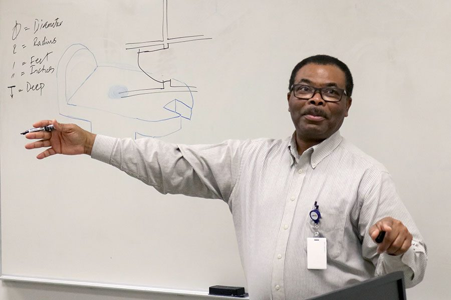 Mr.Madu teaches one of his engineering classes. Madu was an advocate for the school and sponsored seven clubs during his time at CPHS.